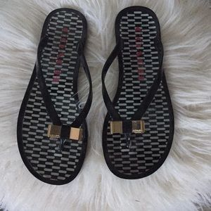 Coach black and white checked flip flops